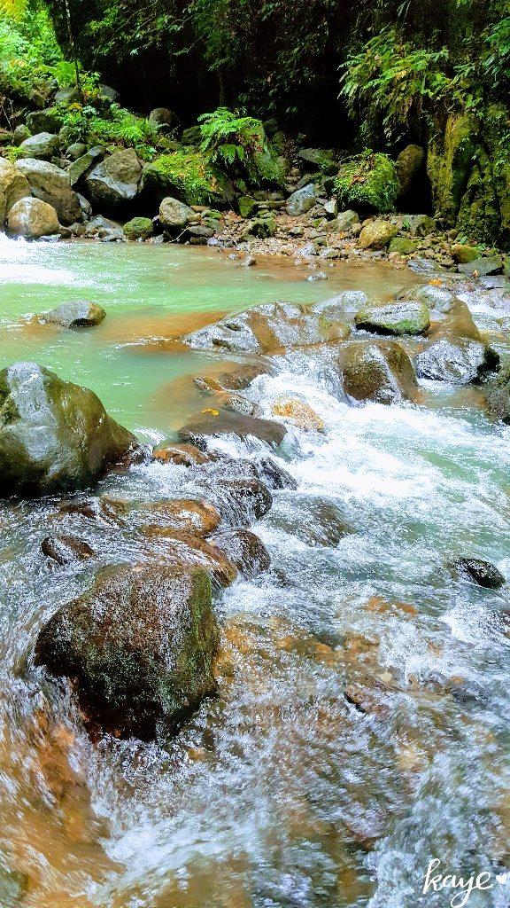Green waters of Casaroro Waterfalls