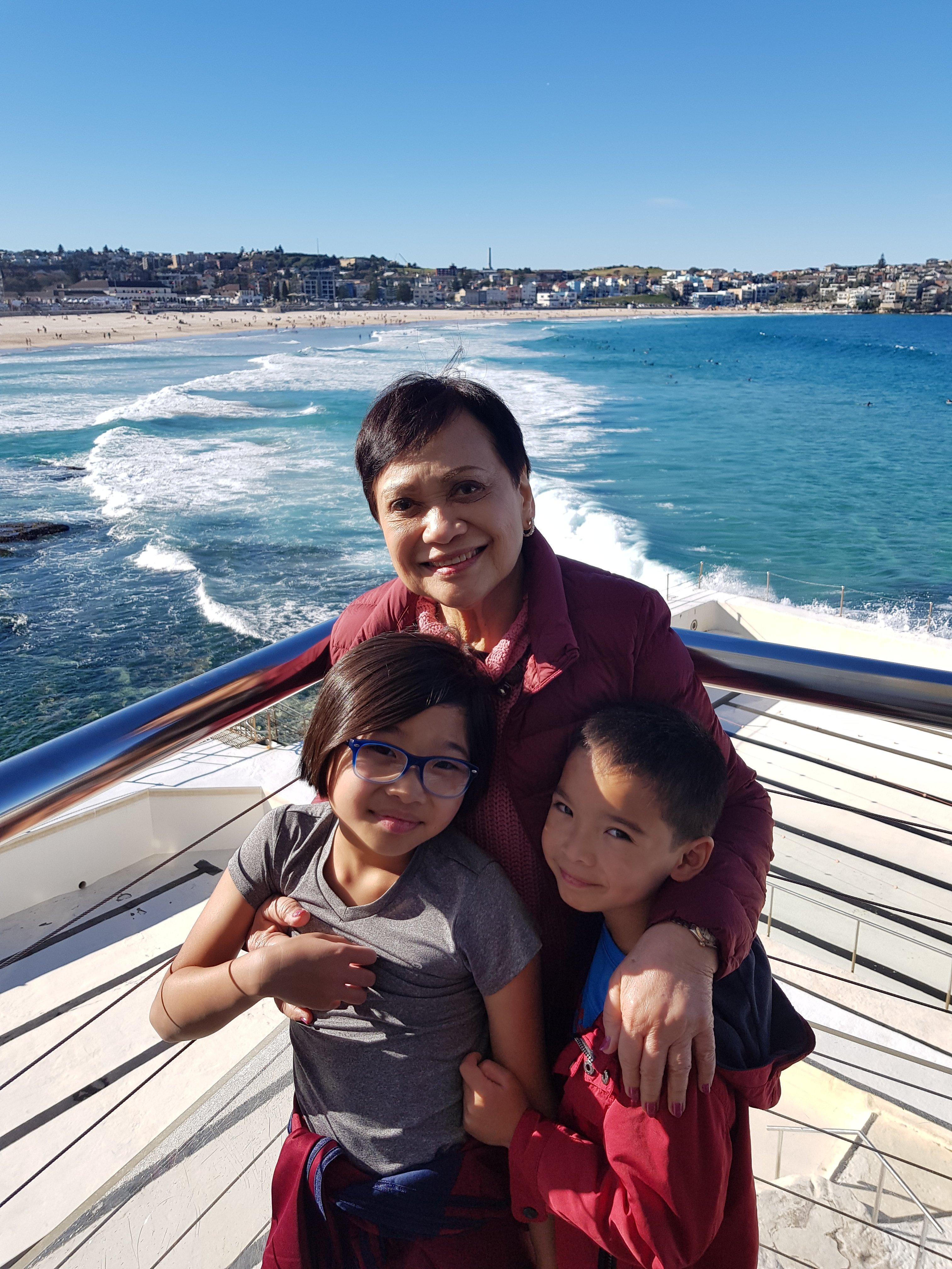 Grandma with grandkids at Bondi Beach