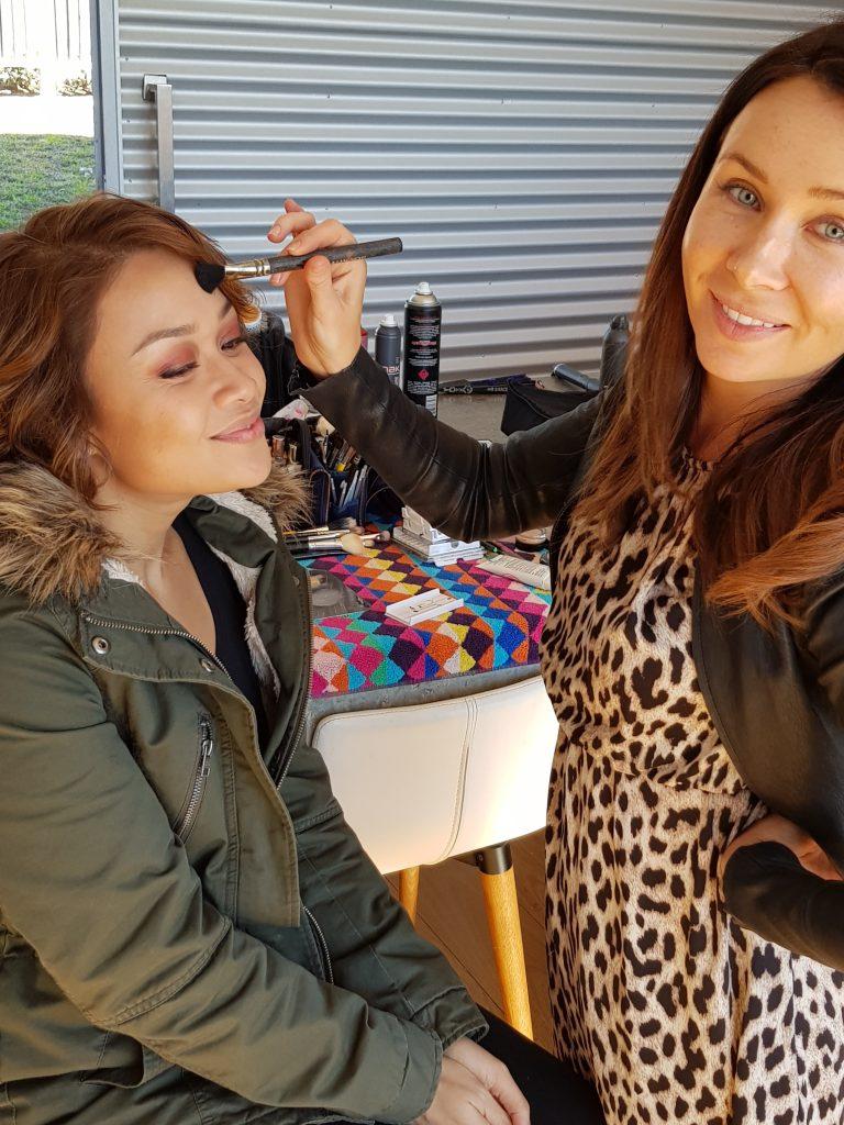Girl and makeup artist