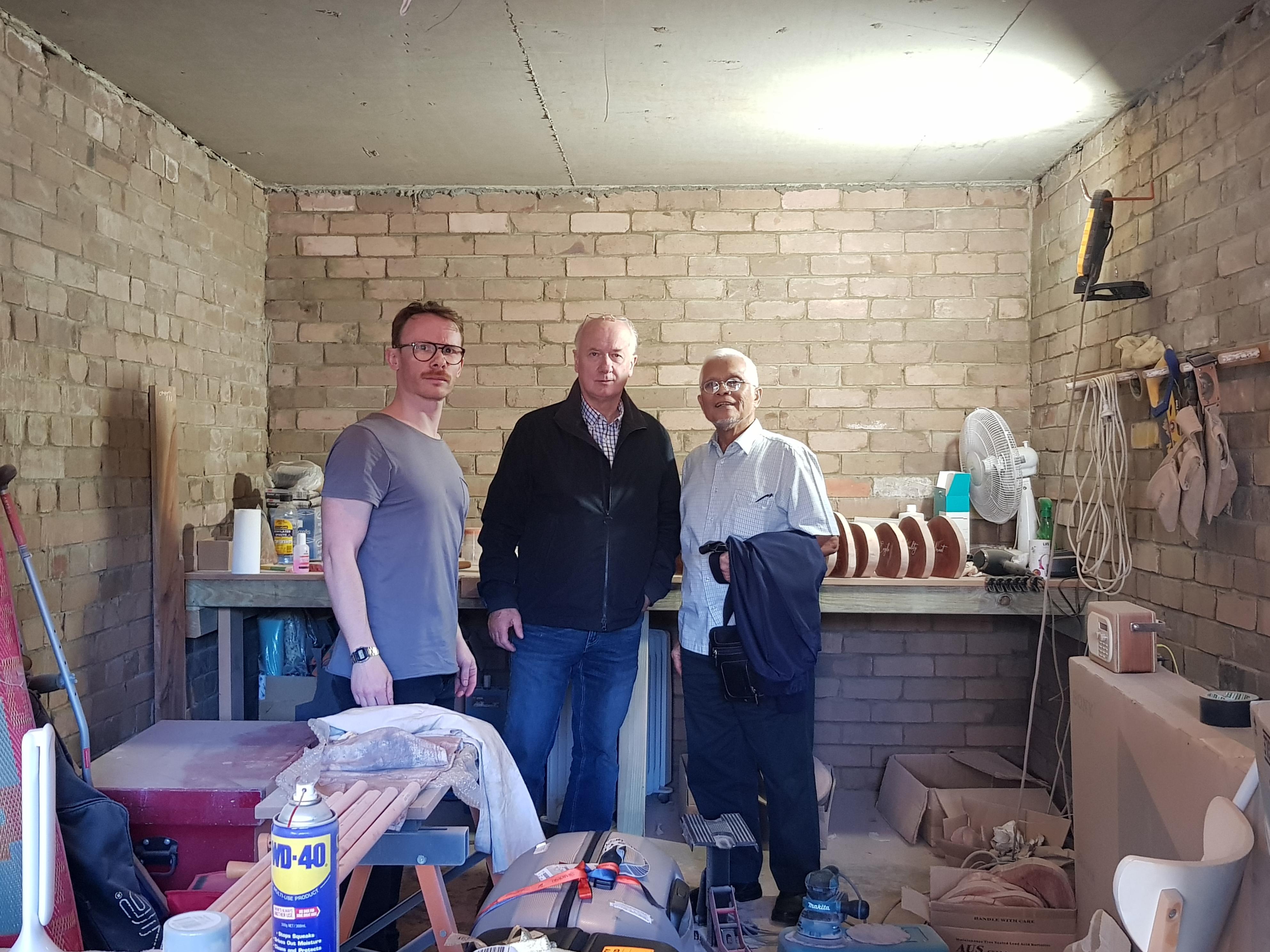 3 men in a garage