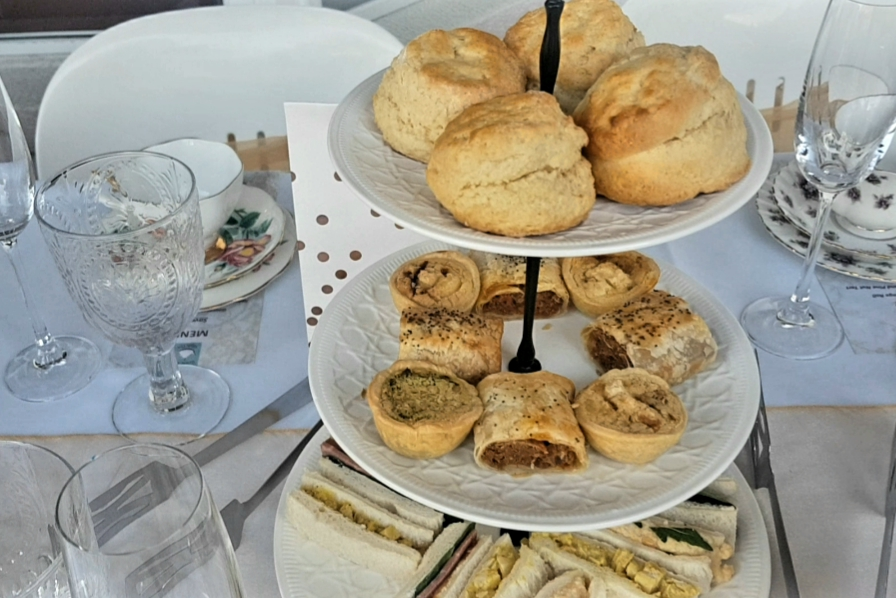 Scones, rolls, and sandwiches for tea time