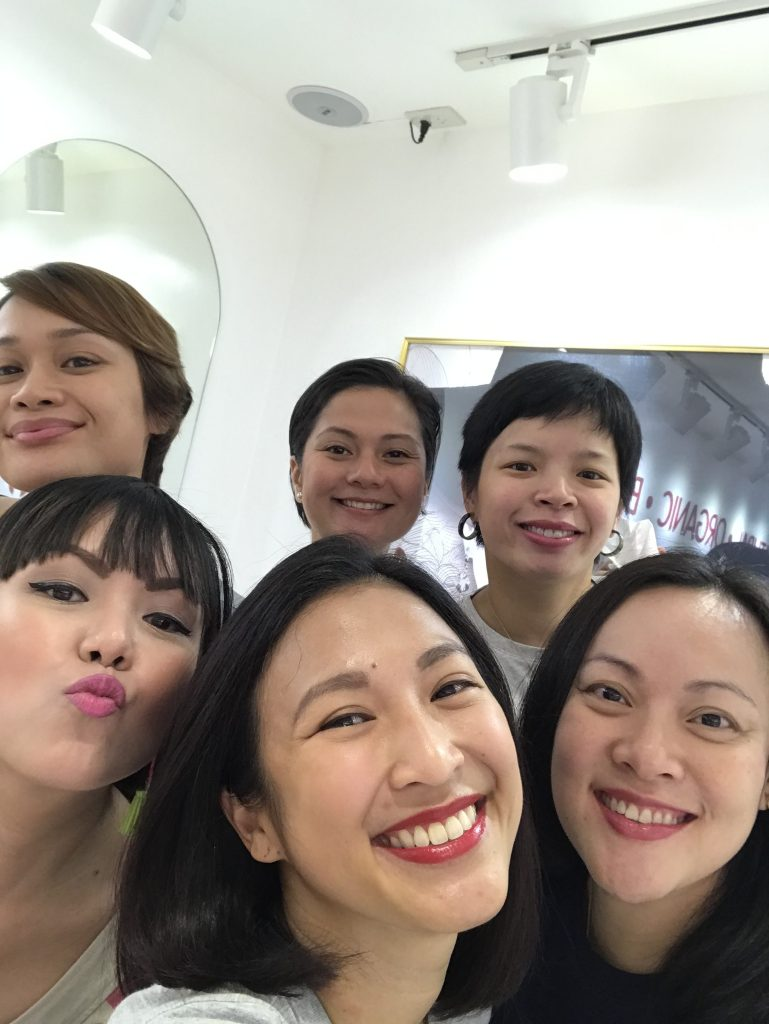 Smiling girls with lipstick on